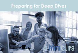 Preparing-for-deep-dive-teachers-round-a-computer